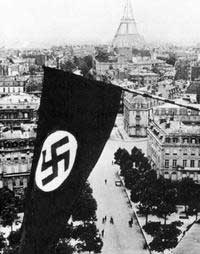 By 1943 Paris was a city under the control of the Nazi-dominated German Army.  Here you see the swastika flag of the Nazis flying high over Paris.  Notice the Eiffel Tower in the background.