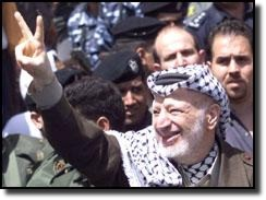 Arafat flashes peace sign after siege at Church of the Nativity.