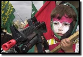 Five-year-old Palestinian boy with realistic toy assault rifle.