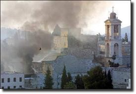 Smoke rises over the Church of the Nativity during fighting at Bethlehem.